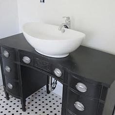 I am SO doing this when we get a house~! How to turn a desk into a sink!