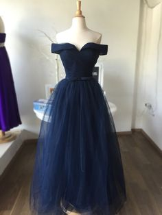 Off shoulder navy prom dress at Moi chic