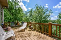 Lazy summer days at 5509 Scalley Lake in Belding start right here on this beautiful backyard deck.