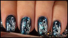 Green and blue glitter polish with a fun swirly white stamped design!