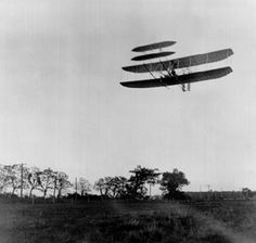 The Wright brothers' first practical flying machine, with Orville Wright at the controls, passes over Huffman Prairie, near Dayton, Ohio, October 4, 1905.