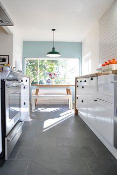 white cabinets, wood worktop, subway tiles, Montauk blue slate floor tiles