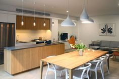 Mezzo Apartments with a Sleek Concrete industrial inspired kitchen with oak timber cabinetry Custom Made Furniture, Furniture Making, Caesarstone Concrete, Smooth Concrete, Wood Look Tile, Concrete Design, Cool Kitchens, Modern Kitchens, Kitchen And Bath