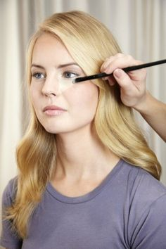 Step 7: Getting Rid of Undereye Circles or Even a Black Eye!  After applying foundation, apply concealer one shade lighter than your skin tone to the area under your eyes. Remember to use it on the area between your eye and nose. If it is looking particularly blue-purple in that area, choose an orange-ish yellow-ish hue of concealer. Blend the concealer well into the foundation that's already there and then set with a translucent powder.