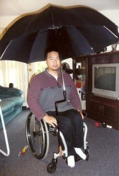 Wheelchair umbrella holder~ Oh that one would work! Possibly even work with a standard umbrella like those glorious rainbow kind, or the black on outside blue sky inside sort. :) ~ #wishlist