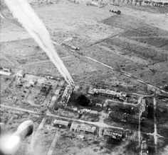 A rocket fired from a Typhoon of No 181 Squadron, Royal Air Force, on its way towards buildings at Carpiquet airfield during the battle for Normandy. The Canadian 3rd Division took Carpiquet to the west of Caen on 4 July. IWM C 4460