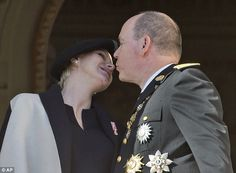 So in love: Prince Albert II of Monaco kisses his wife Princess Charlene on the balcony of the Monaco palace