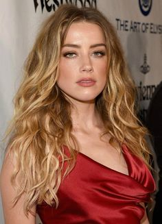 Amber Heard looked grace and elegance personified as she opted to wear figure hugging silky blood-red gown with gathered detail around the bust and waist, while posing for the photographs with husband Johnny Depp on the red carpet at The Art of Elysium's 2016 Heaven Gala held at 3LABS in Culver City, California on January 9, 2016....
