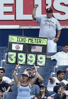 A fan holds a sign honoring Ichiro Suzuki #31 of the New York Yankees on the 3,999th hit of his professional career in the 7th inning against the Toronto Blue Jays during the first game of a double header at Yankee Stadium on August 20, 2013 in the Bronx Borough of New York City. (Photo by Jeff Zelevansky/Getty Images)