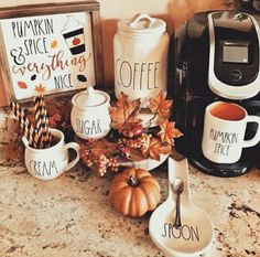This coffee bar on the kitchen counter has been decorated with some Rae Dunn cream and & sugar containers as well as a cute pumpkin spice mug and a spoon rest. The homeowner also added some fall leaves and miniature pumpkins. Autumn Coffee, Autumn Cozy, Coffee Bar Home, Coffee Bars, Seasonal Decor, Holiday Decor, Happy Fall Y'all, Fall Home Decor, Autumn Inspiration