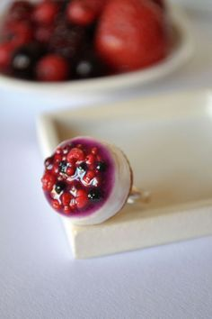 Miniature forest fruits cheesecake placed on a silver plated adjustable ring base :-) The cheesecake measures approximately and is totally handmaded out of polymer clay :-) Bon appetit ; Sweet Desserts, Just Desserts, Fruit Cheesecake, Polymer Clay Ring, Forest Fruits, Digestive Biscuits, Clay Food, Fake Food, Clay Miniatures