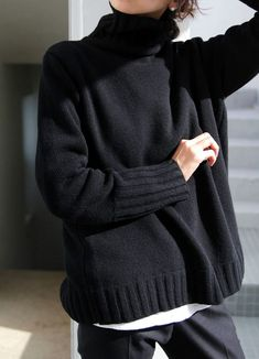 All black knitted turtleneck, white top underneath and black trouserrs / pants | The UNDONE