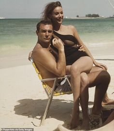 Scottish actor Sean Connery and French actress Claudine Auger pictured together wearing bathing costumes and sitting on a folding chair on a beach in. James Bond Girls, Sean Connery James Bond, Claudine Auger, Nostalgia, Scottish Actors, Bathing Costumes, Sites Online, French Actress, Action Movies