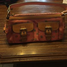 Dooney& Bourke pink shoulder bag 2 front snap pockets and heart zip closure. 2 interior pockets and key clip. Leather strap. 11x2.5x 6.25x8 Dooney & Bourke Bags Shoulder Bags