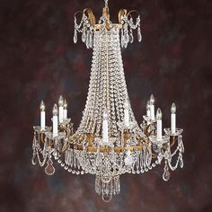 Twelve-light crystal chandelier on an antiqued gilded iron frame. Hand wrought and hand finished in Italy. 30 in. W x 39 in. H