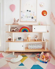 Sweet, simple shelves with hidden places for surprises (or for messier items) and I love the colors here too