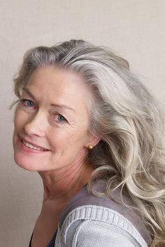 My hair will be this gray in a few years.....If I can have pretty gray hair, then I don't mind it. I just don't want dried out frizzy ugly old lady gray hair. This gal's hair looks good.