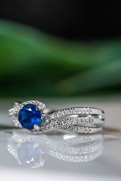 Obsessing over this swirl engagement ring with a sapphire center stone.