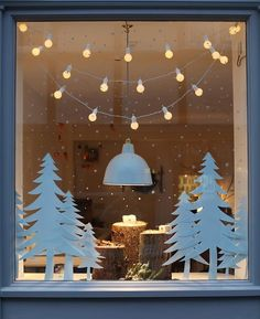 Simple and lovely, this window treatment could be done on a smaller scale at home with some paper cut-outs, twinkle lights or candles, and a white dry-erase marker.