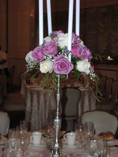 Silver Candelabra with lavender and ivory roses simple and sweet.