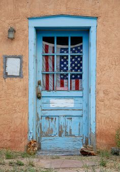 A classic turquoise blue door on an adobe house in Santa Fe, New Mexico
