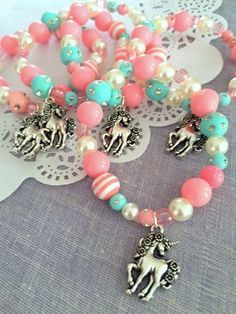 Unicorn kids birthday party favor, unicorn jewelry, kids jewelry, SET of TEN. ************************** Party planning is already so stressful. Leave the favors up to us! This listing is for TEN bracelets. DETAILS and MEASUREMENTS: Beads vary in sizes from 6mm-10mm. The length of a bracelet is 6.5 (we can make them smaller or bigger for you). COLOUR