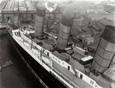"RMS Lusitania had an unusually clean and uncluttered appearance topside because of her cutting-edge ventilators with pop-up 'lids.' The ventilators were atop shafts that pierced down to the coal-burning steam boilers, which gulped prodigious amounts of oxygen. The smoke produced then whooshed up other shafts to the giant funnels. This created a forest of ""casings"" through the ship's interior. Yet designers managed to create bright, elegant public rooms beyond the doors you see. JC"