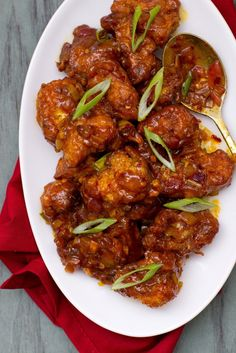 Gobi Manchurian- Fried Cauliflower in Spicy Sauce - This sounds fantastic! Only I will not fry the cauliflower. I would batter it and cook it in the oven for 15-20 minutes.