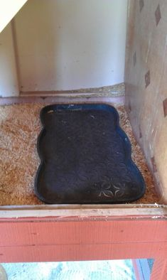 "Use a plastic ""boot tray"" to cover the poop board under the roosting poles in the chicken coop. Line it with newspaper for easy clean up every few days! #chickencoopideas"