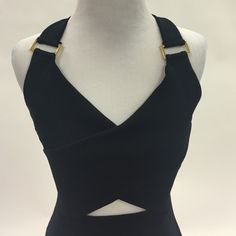 Black Cutout Bodycon Dress Black stretchy club dress. Gold metal detail. Front cut out and X back. Super comfy and can fit many sizes. I wore (usually I'm a 2-4) and it's a UK size 12 (US size 8). No trades. Dresses Mini