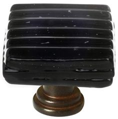 View the Sietto K-802 Texture Series 1-1/4 Inch Square Cabinet Knob with Black Reed Glass at PullsDirect.com.