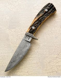 Who are the top custom fixed blade hunting knife makers in the world (USING KNIVES)