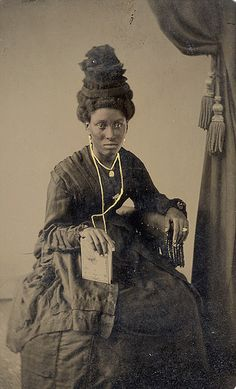 """Tintype - Black Woman with Wonderful Hat Even though the tintype was often casual it was also sometimes very formal. In this image a black woman poses for her picture in what must be her """"Sunday best""""."""
