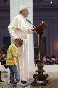 Boy Wanders Onto Stage To Hang Out With Pope Francis. Pope does not object. Awesome.
