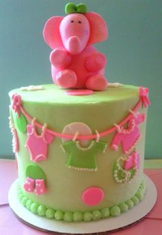 Baby cake with clothes on a line and sugarpaste elephant #sugarcraft #baking #cakes