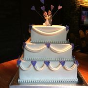 Wedding cake with drapes and hearts