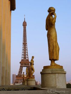 Taken from a side of the Palais de Chaillot building, showing some of the amazing golden statues with the Eiffel Tower in the distance.  http://www.eutouring.com/