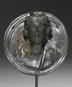 A ROMAN BRONZE ROUNDEL WITH RELIEF BUST OF DIONYSOS, CIRCA 2ND CENTURY A.D. | Sotheby's