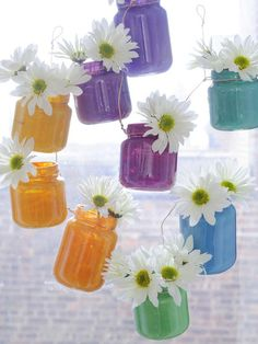 Painted baby food jars make a brilliant window display for blooms, so even if your little one is not a fan of strained peas, at least you can turn the jars into something a little more appealing.
