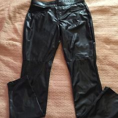 Hue  Leatherette Skimmer These black are 88% polyester, 12% spandex. Coating polyurethane . . These are pull up with two zipper pockets in front and two regular pockets in back . On front has a seam up above knees HUE Pants