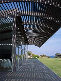 House in Corsica - Foster + Partners (1993)     Terrace with exposed beams extending out from house