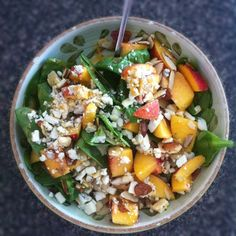 Spinach Salad with Fresh Late Summer Peaches, Gorgonzola and Almonds- fresh baby spinach leaves  1 oz crumbled gorgonzola  2 heaping tablespoons sliced almonds  1 peach, sliced or cut in chunks  Annie's Organic Papaya Poppyseed dressing or your favorite poppyseed dressing