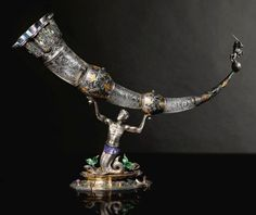 An Austro-Hungarian Jeweled Silver, Enamel, and Rock Crystal Drinking Horn, 19th Century.
