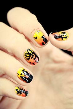 Beautiful sunset nails get seriously spooky with haunted houses, trees, black cats and — of course — tons of flying bats. It's everything you love about scary movies, all rolled into one manicure. Get the tutorial at Pshiiit »  - GoodHousekeeping.com