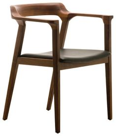 If comfort is key to enjoying your meal, meet your new dining chair. Yes, it's got impeccably sleek and stylish design. But with a slightly padded, top-grain