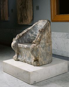 "Ceremonial Chair (The Elgin Throne)  Greek, 400 - 300 B.C.  Marble  The J. Paul Getty Museum  ""A rare surviving example of Greek marble furniture, the Elgin Throneoriginally was placed in a public space in Athens, perhaps in the Theater of Dionysos, where it would have been a seat of honor. The decoration on the sides of the chair appears connected with this official function."""