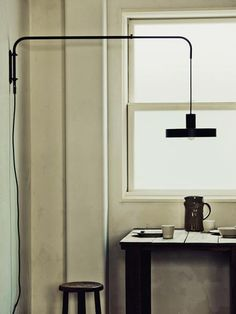 Flame lighting by Kenichi Kandatsu from Kobe Japan via Remodelista Casa Milano, Interiores Design, Desk Lamp, Chandeliers, Lighting Design, Interior Architecture, Light Fixtures, Wall Lights, Indoor