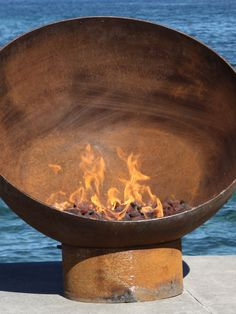 Large spherical design constructed from superior-quality American made steels renders the Meridian Sculptural Firebowl efficient and aesthetically pleasing when entertaining outdoors. Easily rotates on base to desired position or to shelter from breezes. Burns wood and quickly converts to clean-burning propane or natural gas fuels as desired.