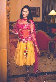 A knee-length bright pink and yellow lehenga from Saaj by Ankita Chaudary for the Mehendi of Monica Singh of WeddingSutra. Photo courtesy- Romesh Dhamija Productions #weddingsutrap2w