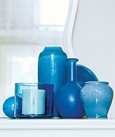 A tight grouping of several small vases hides individual imperfections while creating a sculptural effect.